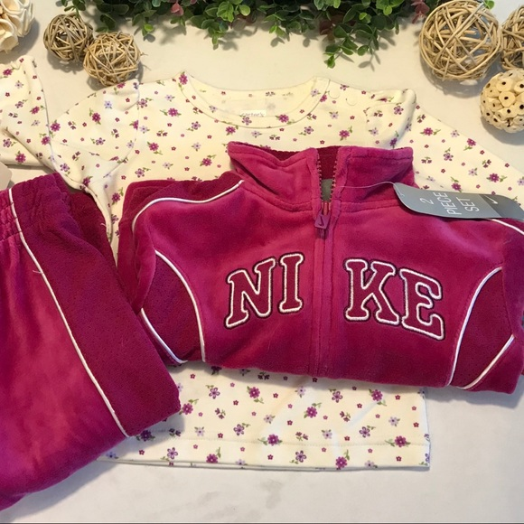 Rose pink Nike jogging suit and matching top